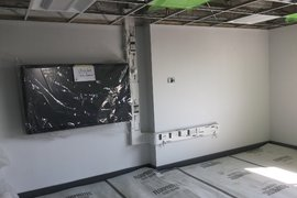 Classroom Audio Visual equipment underway following installation of vinyl and carpet floor coverings.