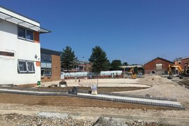 Rear playground currently being shaped with ramps completed.  Tarmac surface booked for week commencing 6 August.
