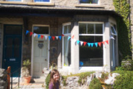 Katy decorating her house for VE Day.