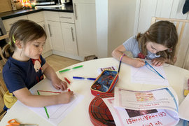 Keira and her sister busy making bunting for their VE Day celebrations.