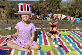 Lily really getting into the spirit of things with a tea party in the sunshine.
