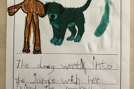 Felicity using her imagination to write about why the dog may have turned green!