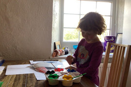Lily busy painting.