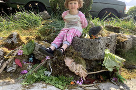 Lily built a troll's house in the garden and made space for his friends so he didn't get lonely.