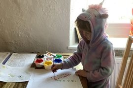 Is it a unicorn? No it's just Lily in her onesie drawing a flower in the style of Yayoi Kusama - lovely work Lily!