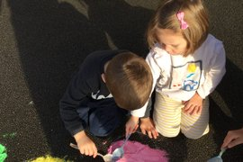 We all helped to make a very large Rangoli pattern in our playground.