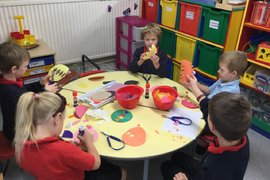 Busy making Rangoli patterns to decorate our classroom windows.