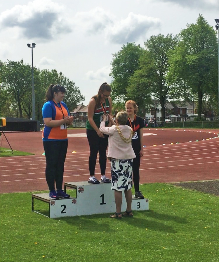 Image of Hannah receiving her medal