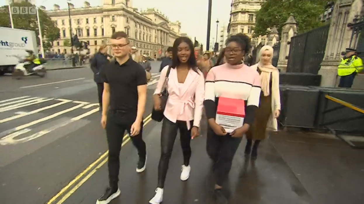 Students in London visiting Parliament walking down the street