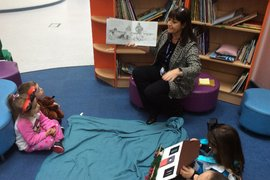 World Book Day winners enjoying hot chocolate and a story, with Mrs Robinson.