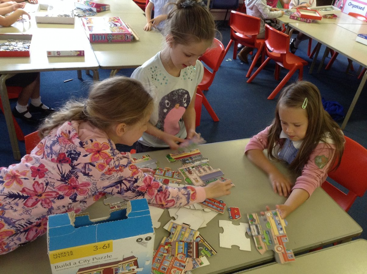EYFS and KS1 solve jigsaw puzzles | Carleton Green Community