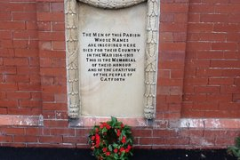 The memorial plaque on the front of the village hall.