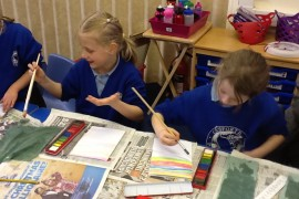 Tiger Class learning how to make a colour wash.