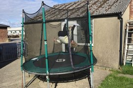 Abigail learning to do somsersaults on the trampoline!