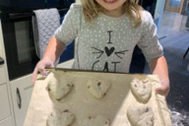 Baking - heart shaped scones.  I bet they were delicious!