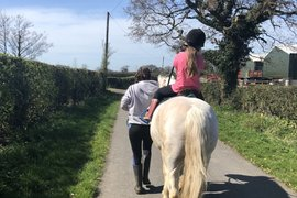 Bella riding and helping out around the farm