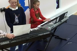 Zara and Mia playing ' We wish you a merry Christmas'