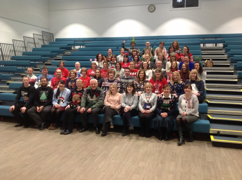 staff wear their christmas jumpers