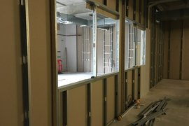 The internal windows formed between one of the IT suites and the technology workshop.