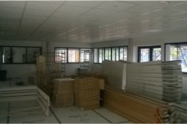 Design and technology suite being used as a holding room, but floor, walls and ceilings completed.