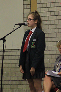 Victoria Rowe sings at the Awards Assembly