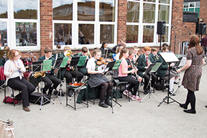 The concert band playing at the summer fair