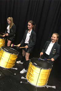 Pupils play drums at St John Rigby