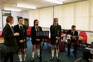 Pupils rehearsing for Wigan Rock Festival