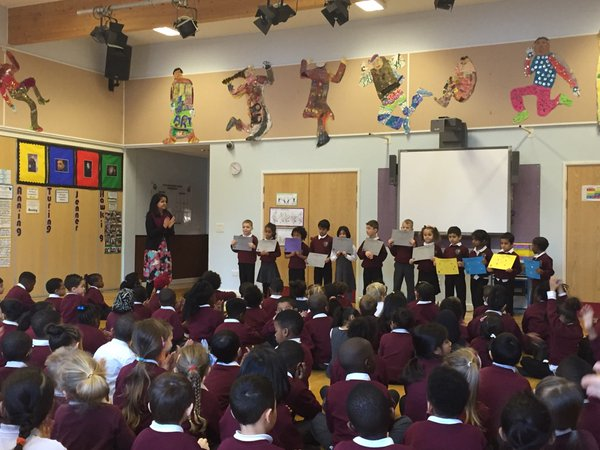 Pupils receiving their 'Star of the Week' certificates.