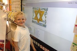 Reception children learning about Judaism - what the Star of David is and what it represents.